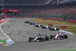 Lewis Hamilton, Mercedes-AMG F1 W09 and Esteban Ocon, Force India VJM11