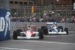 Ayrton Senna, Mclaren MP4/5B Honda leads Jean Alesi, Tyrrell 018 Ford as they battle hard at the front