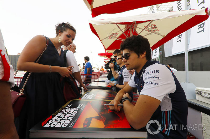 Lance Stroll, Williams Racing, signs autographs