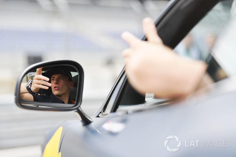Max Verstappen, Red Bull Racing in an Aston Martin