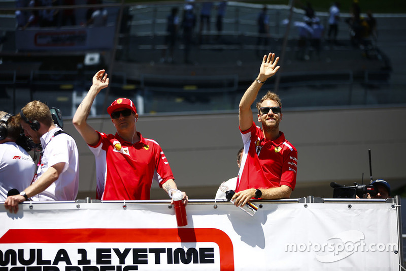 Kimi Raikkonen, Ferrari, and Sebastian Vettel, Ferrari, in the drivers parade