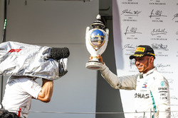 Lewis Hamilton, Mercedes AMG F1, 1st position, with his trophy on the podium