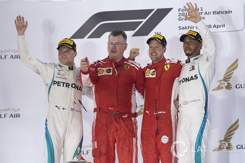 Valtteri Bottas, Mercedes AMG F1, 2nd position, The Ferrari Constructors Trophy delegate, Sebastian Vettel, Ferrari, 1st position, and Lewis Hamilton, Mercedes AMG F1, 3rd position, on the podium