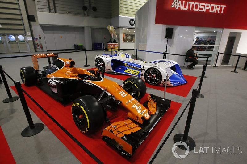 A McLaren and Robocar on display