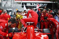 Sebastian Vettel, Ferrari, exits his car on the grid