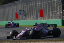 Sergio Perez, Force India VJM10, leads Carlos Sainz Jr., Scuderia Toro Rosso STR12