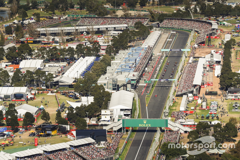 The drivers head off from the grid for the second formation lap