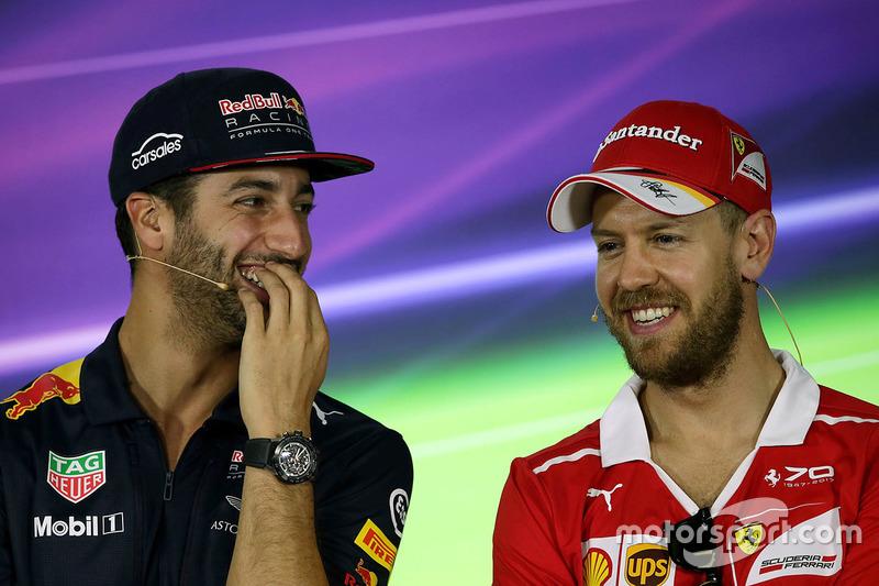 Daniel Ricciardo, Red Bull Racing; Sebastian Vettel, Ferrari