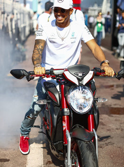 Lewis Hamilton, Mercedes AMG F1, does a burn out on his motorcycle