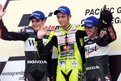 Podium: winner Valentino Rossi, second place Alex Barros, third place Loris Capirossi