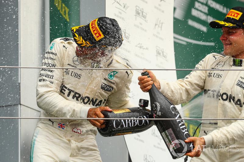 Valtteri Bottas, Mercedes AMG F1 and Lewis Hamilton, Mercedes AMG F1 celebrate on the podium, the ch