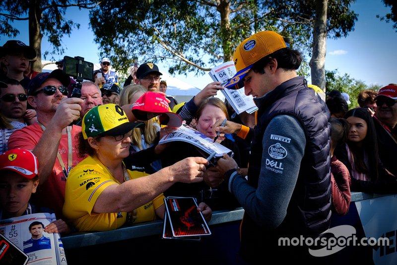 Carlos Sainz Jr., McLaren signs autographs for fans