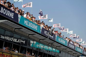 Fans watch from the roof top above the pits
