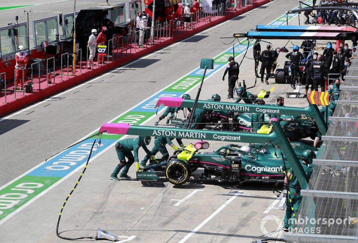 Sebastian Vettel, Aston Martin AMR21, is returned to the garage