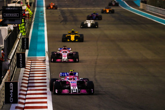Esteban Ocon, Racing Point Force India VJM11, leads Sergio Perez, Racing Point Force India VJM11, and Carlos Sainz Jr., Renault Sport F1 Team R.S. 18