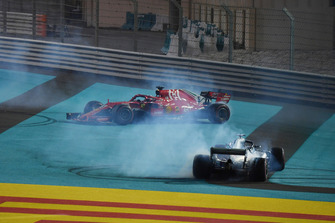 Lewis Hamilton, Mercedes-AMG F1 W09 and Sebastian Vettel, Ferrari SF71H donuts at the end of the race