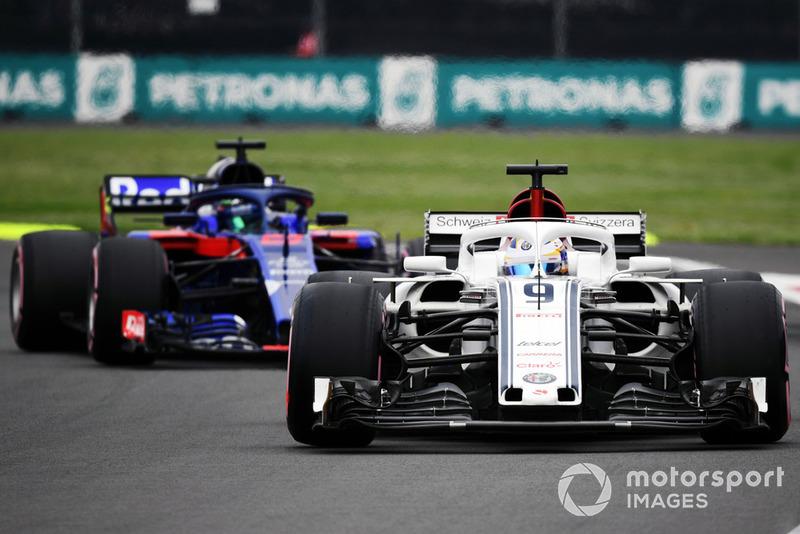 Marcus Ericsson, Sauber C37 and Brendon Hartley, Scuderia Toro Rosso STR13