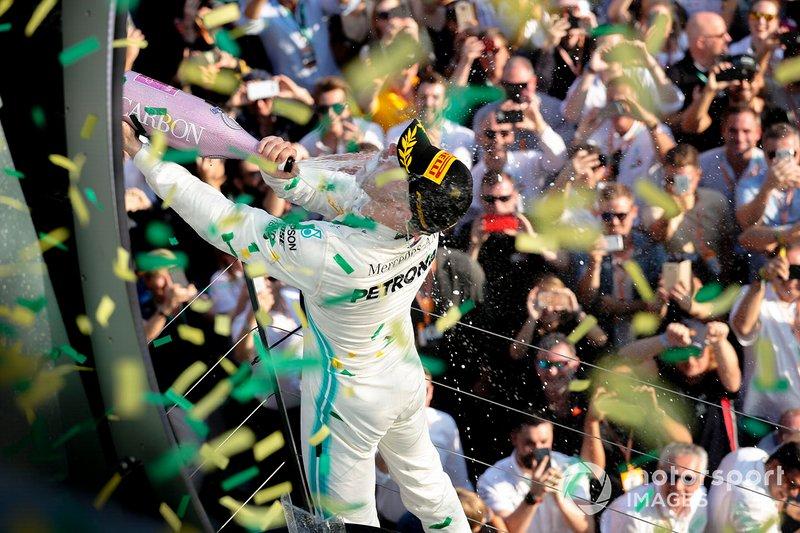 Valtteri Bottas, Mercedes AMG F1, 1st position, celebrates with Champagne on the podium