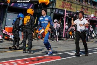 Carlos Sainz Jr, McLaren, heads back to his garage, Jean-Michel Tibi, FOM Cameraman