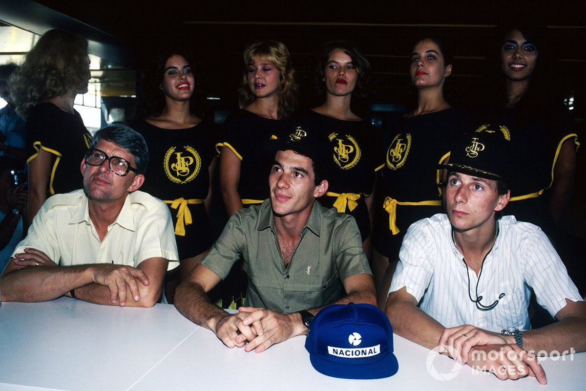 A Lotus press conference for the first race of the season: Peter Warr, Lotus Team Manager, Ayrton Senna, and team mate Johnny Dumfries