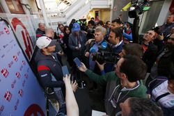 A media scrum surrounds Romain Grosjean, Haas F1 Team