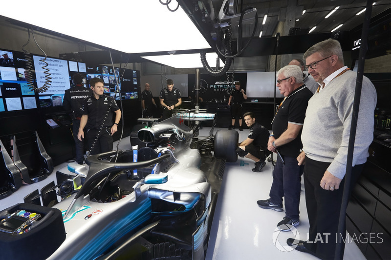 Ross Brawn, Managing Director of Motorsports, FOM, visits the Mercedes garage for a look at the Halo device fitted to the car of Lewis Hamilton, Mercedes AMG F1 W08