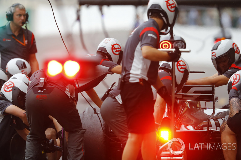 The Haas F1 Team pit crew at work during practice