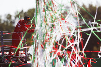 Streamers fall during the podium ceremony as Third place Sebastian Vettel, Ferrari, sprays Champagne