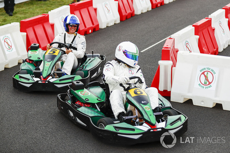 David Coulthard races football player Christian Karembeu in karts
