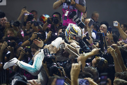Lewis Hamilton, Mercedes AMG F1 crown surfs after winning the Singapore GP