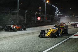 Jolyon Palmer, Renault Sport F1 Team RS17, passes the stricken car of Sebastian Vettel, Ferrari SF70H