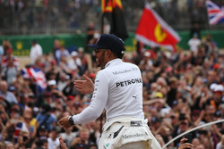 Race winner Lewis Hamilton, Mercedes AMG F1, celebrates a home race victory, the fans