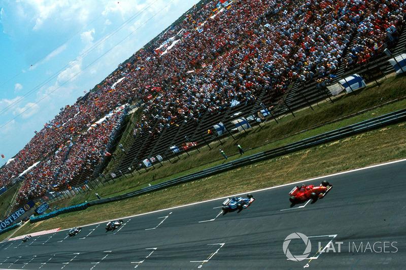 Michael Schumacher, Ferrari F310B, Damon Hill, Arrows