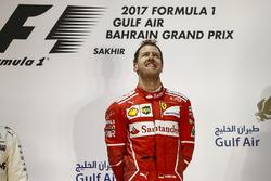 Sebastian Vettel, Ferrari, 1st Position, on the podium