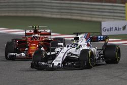 Felipe Massa, Williams FW40, leads Kimi Raikkonen, Ferrari SF70H