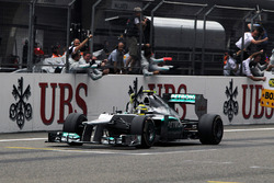 Nico Rosberg, Mercedes AMG F1 W03 crosses the line to win the race
