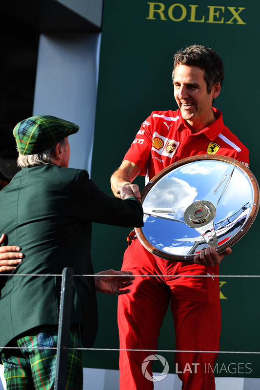 Inaki Rueda, Ferrari Race Strategist celebrates with the trophy on the podium