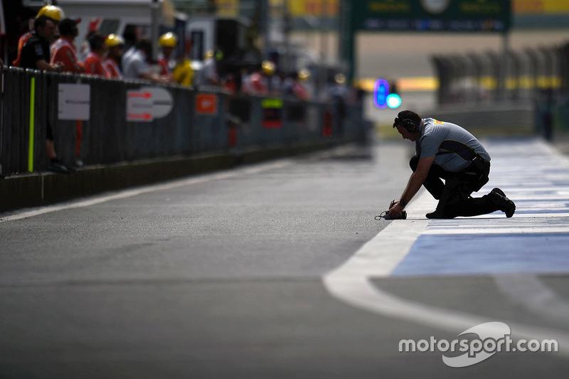 Pirelli tyre technician in the pits