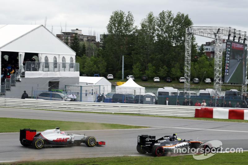 Серхіо Перес, Sahara Force India F1 VJM09 та Ромен Грожан, Haas F1 Team VF-16 боротьба за позицію