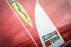 Ferrari logo covererd in rain drops