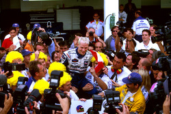 Jacques Villeneuve and his Williams crew celebrate Drivers World Championship title