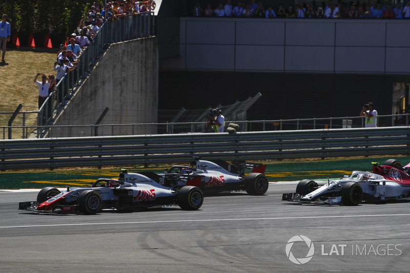 Kevin Magnussen, Haas F1 Team VF-18, leads Romain Grosjean, Haas F1 Team VF-18, and Charles Leclerc, Sauber C37