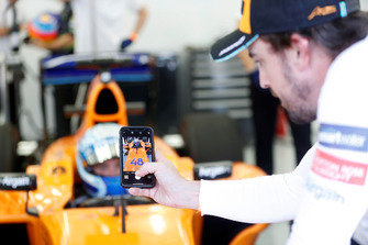 Jimmie Johnson in the McLaren, Fernando Alonso takes a photo