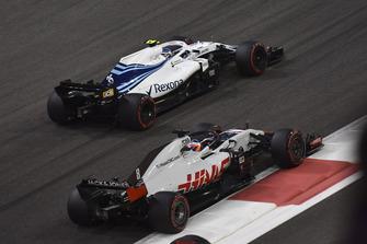 Romain Grosjean, Haas F1 Team VF-18 and Sergey Sirotkin, Williams FW41 battle