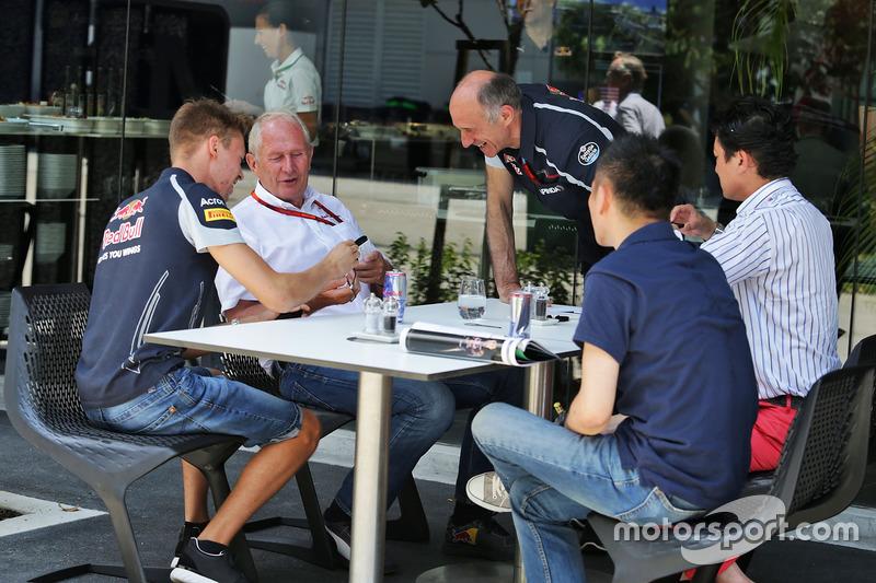 (L to R): Daniil Kvyat, Scuderia Toro Rosso with Dr Helmut Marko, Red Bull Motorsport Consultant and Franz Tost, Scuderia Toro Rosso Team Principal