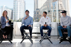 Reporter Kelli Stavast hosts a panel discussion with drivers Daniel Suarez, Kyle Larson and Ryan Bla