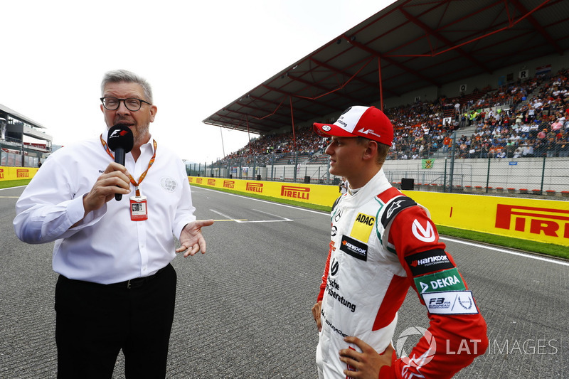 Mick Schumacher talkes to Ross Brawn, Managing Director of Motorsports, FOM