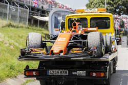 The car of Stoffel Vandoorne, McLaren MCL32, is returned to the garage on a flat bed truck