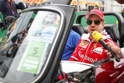 Sebastian Vettel, Ferrari talks to the media on the drivers parade