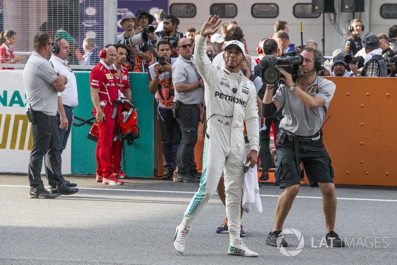 Pole sitter Lewis Hamilton, Mercedes AMG F1 celebrates in parc ferme
